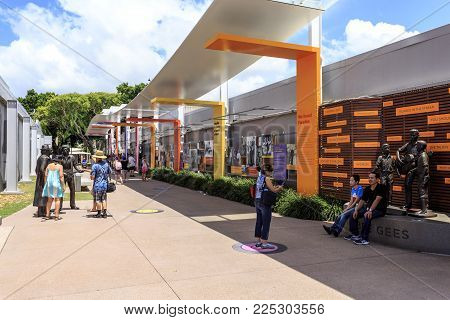 REDCLIFFE, AUSTRALIA - January 26, 2018: People visiting the Bee Gees Celebration Memorial in their home town of Redcliffe, Queensland, Australia