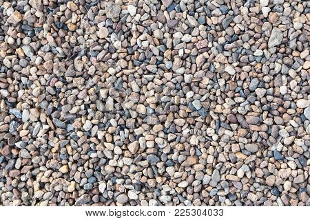 Stone pebbles texture or stone pebbles background. stone pebbles for interior exterior decoration and industrial construction concept design. stone pebbles motifs that occurs natural.