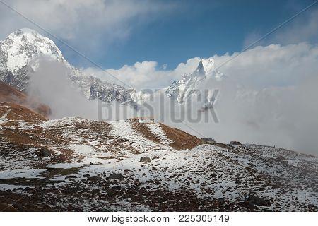 Small lodge mislaid among mountain tops. Nepal. Himalayas
