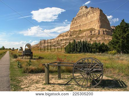 Path/trail by Mitchell Pass with covered wagons at Scotts Bluff National Monument in Nebraska; part of the historic Oregon Trail, California Trail, & Mormon Trail.