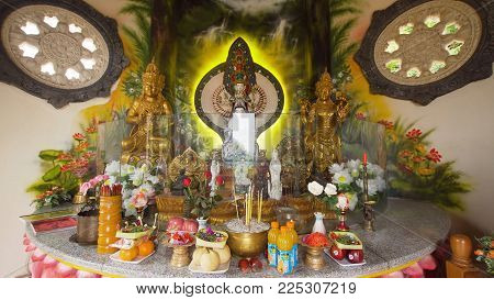 Bali, Indonesia - October 15, 2017: Statue of the Buddha god, Sacrifice oblation, traditional offerings for Gods in the Buddhist temple Brahma Vihara Indonesia. Bali Architecture, Ancient design. Travel concept.