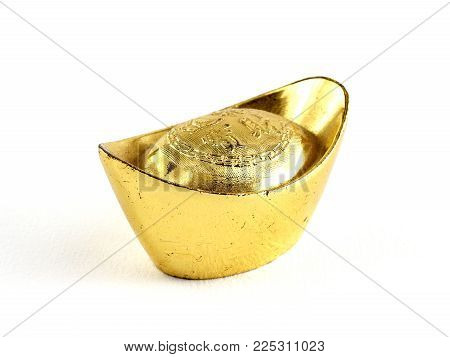 close-up antique chinese gold ingot isolated on white background, chinese characters on gold ingot means making plenty of money