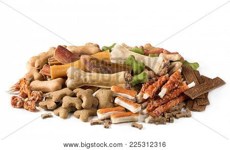 Assortment of dog snacks isolated on a white background