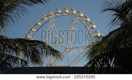 Ferris wheel in Manila, Mall of Asia. Ferris wheel against a blue sky. Philippines.