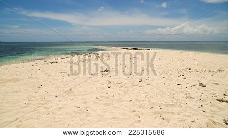 Beach with white sand on a tropical island. Seascape ocean and beautiful beach paradise, Siargao, Philippines. Tropical landscape. Travel concept.