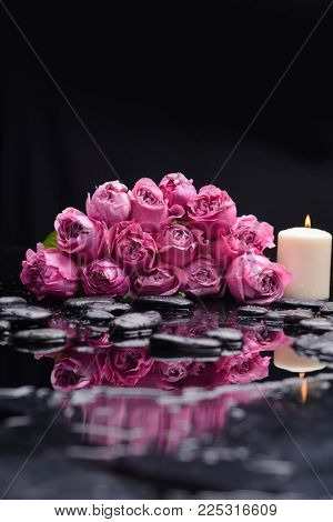 bouquet, rose ,petals with candle and therapy stones reflection