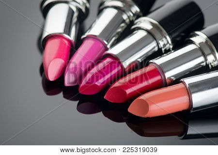 Lipstick. Fashion Colorful Lipsticks over black background. Lipstick tints palette, Professional Makeup and Beauty. Beautiful Make-up concept. Lipgloss. Lipsticks closeup