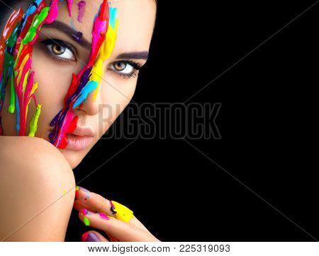 Fashion Model Girl colorful face paint. Beauty fashion art portrait of beautiful woman with flowing liquid paint, abstract makeup. Vivid paint make-up, bright colors. Vogue Multicolor creative make-up