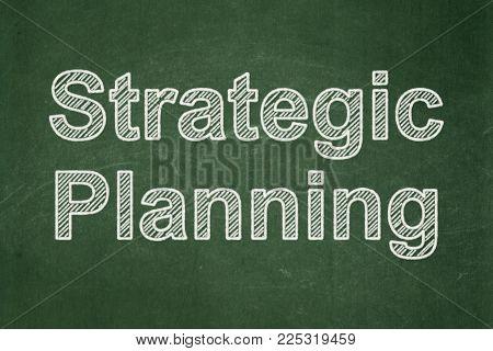 Finance concept: text Strategic Planning on Green chalkboard background