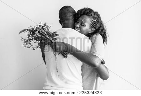 African descent couple hugging