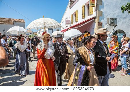 Saintes-Maries-de-la-Mer, Provence, France - May 25, 2015. Religious feast in honor of the Holy Maries in Provence. The concept of ethnographic tourism. Residents of the city in ancient dresses