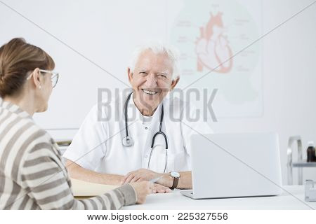 Cardiologist With Patient