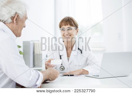 Doctor Handing In Card