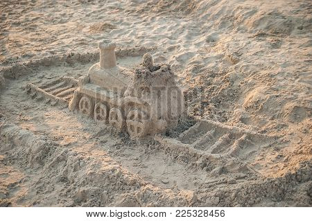 Sand Sculpture On The Sea Beach In Summer Sunset