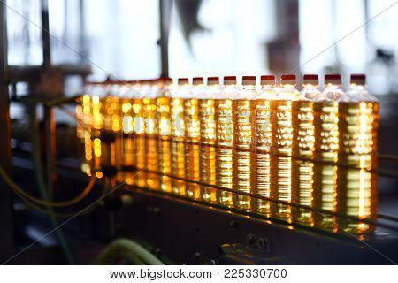 Sunflower oil. Line for the production and bottling of refined oil from sunflower seeds. Conveyor of food industry