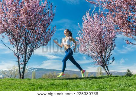 Woman running for fitness on a sunny spring day