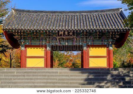 Beautiful entrance gate of Bulguksa temple in autumn, Gyeongju, South Korea ( sign board reads