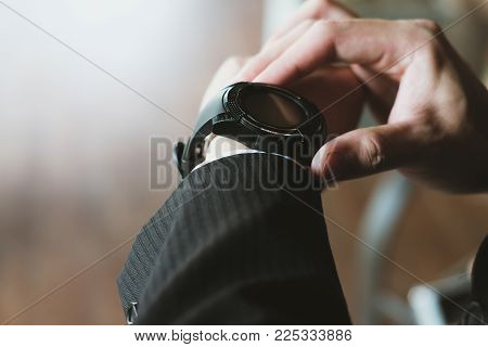 busy businessman look at watch at workplace. startup man check time on wristwatch. young male entrepreneur late for work