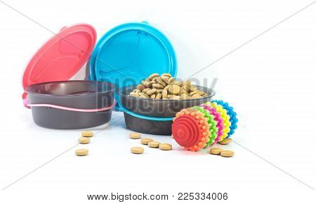 Portable bowls feeding and food with toys isolated on white background.
