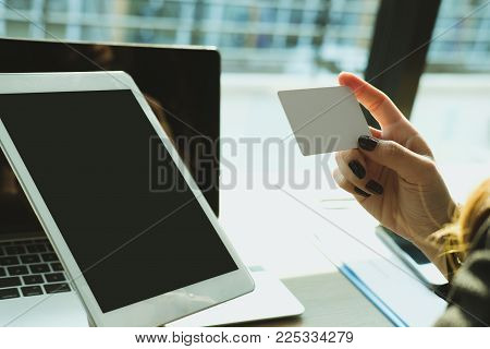 Woman Holding A Credit Card And Using Tablet For Online Shopping At Cafe. Businesswoman Purchase Goo