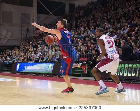 SAMARA, RUSSIA - DECEMBER 01: BC CSKA guard Vitaly Fridzon #7, with ball, is on the attack during the BC Krasnye Krylia game on December 01, 2013 in Samara, Russia.
