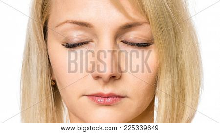 Beauty woman face with eyes closed, close up portrait. Young cute girl showing different emotions - calmness.