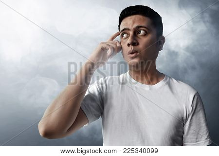 Asian man thinking expression on smoke background