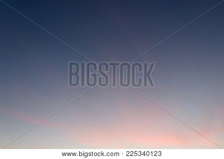 plain blue and orange sky background, blue sky, orange tinge sunset, clear plain background