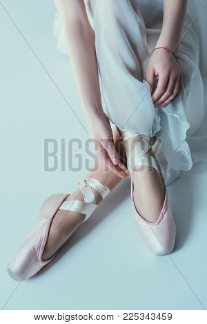 Low Section View Of Elegant Ballerina In White Dress And Ballet Shoes