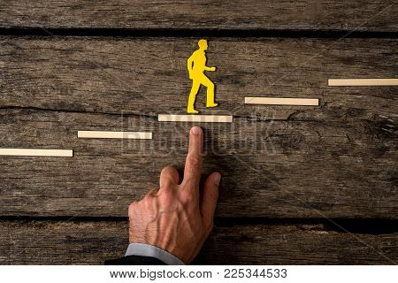 Businessman Climbing The Steps In A Conceptual Image