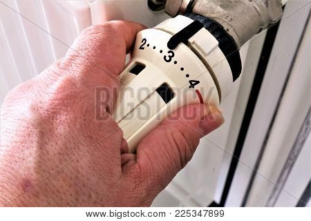 An concept Image of a Thermostat with a hand