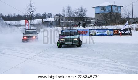Yoshkar-ola, Russia - January 21, 2018: Winter Auto Show - Drift On Cars On An Ice Track, On A Froze
