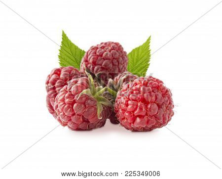 Raspberries with leaves isolated on white. Raspberry close-up. Vegetarian or healthy eating. Juicy and delicious raspberries on a white background.