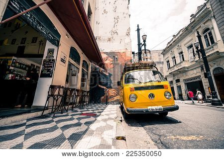 SAO PAULO, BRAZIL - FEBRUARY 02: Wide angle picture of local buses in front of old buildings in central area of Sao Paulo, Brazil.