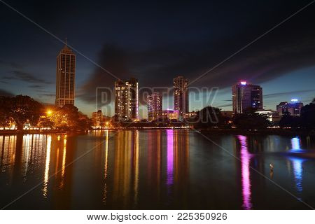 The Skyline Of Colombo With Reflection In The Lake At Night