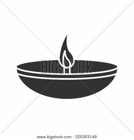 Islamic oil lamp glyph icon. Diya. Islamic culture. Burning bowl oil lamp. Silhouette symbol. Negative space. Vector isolated illustration