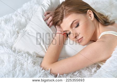Portrait Of A Young Beautiful Woman Sleeping In Bed