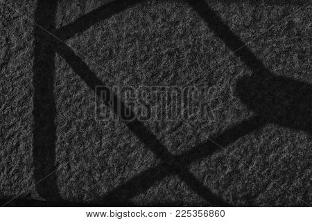 Grey wall stone grunge background, rock texture with shadow.