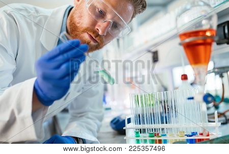 Student of chemistry working with chemicals in laboratory