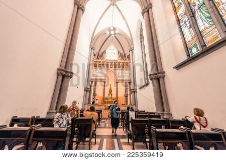 SAO PAULO, BRAZIL - FEBRUARY 02: Vertical picture of the plaza in front of Se Cathedral with palms and a beautiful statue in Sao Paulo, Brazil