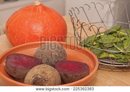It Is Image Of Pumpkin,beet And Spinach.