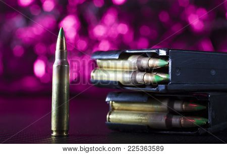 M855 Ammunition With Two Metal Magazines And Purple Behind