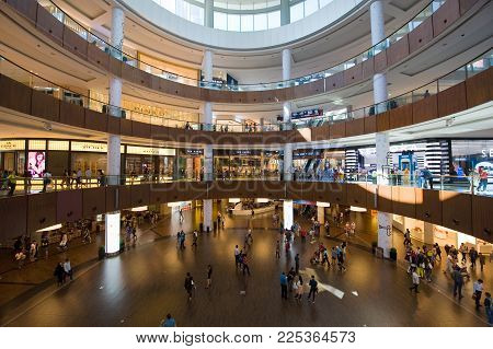 DUBAI, UNITED ARAB EMIRATES - JAN 02, 2018: Dubai shopping mall in the centre with more than 1200 shops is the biggest shopping mall in the world.