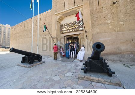 DUBAI, UNITED ARAB EMIRATES - JAN 02, 2018: The entrance of the Dubai museum with two cannons in front. It's a famous place visited by tourists.