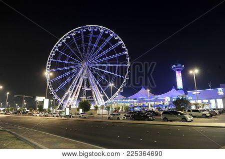 ABU DHABI, UNITED ARAB EMIRATES - 02 JAN, 2018: The Marina eye is a Ferris Wheel on Corniche near the centre of Abu Dhabi.