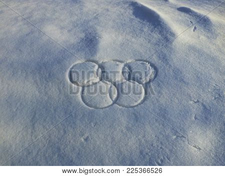 Tyumen,  Russia - 6 February 2018: Five circle traces in the snow in the shape of sport symbol. Winter Olympic games background.