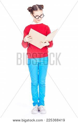 Portrait of Asian school girl with nerd eyeglasses holding open book, isolated on white