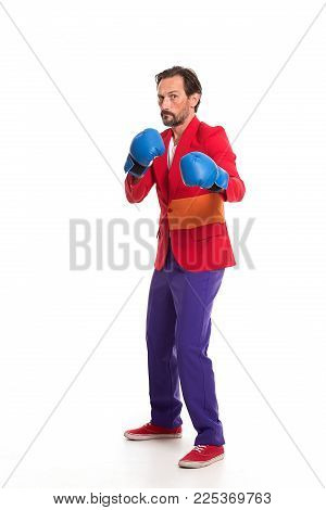 Adult male boxer in colorful clothes. Boxing concept.