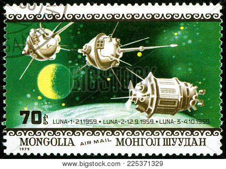 Ukraine - circa 2018: A postage stamp printed in Mongolia show interplanetary stations Luna 1, 2 and 3. Series: Air Mail. Apollo 11 Moon Landing 10th Anniversary. Circa 1979.
