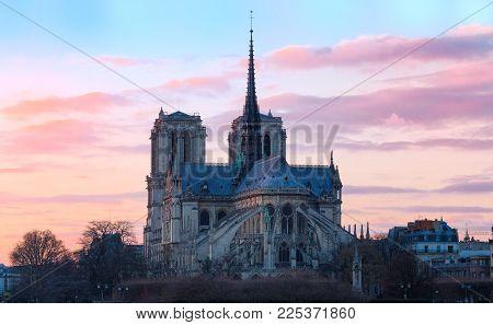 The Notre Dame cahedral at sunset. It is historic Catholic cathedral, one of the most visited monuments in Paris, considered as one of the finest examples of French Gothic architecture.